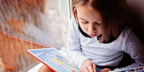 Photo of a child reading