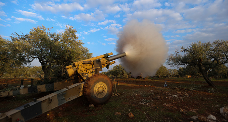 Photo of Turkish back Syrian fighters firing a howitzer in Neirab