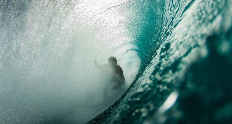 Surfer in the barrel of a wave .
