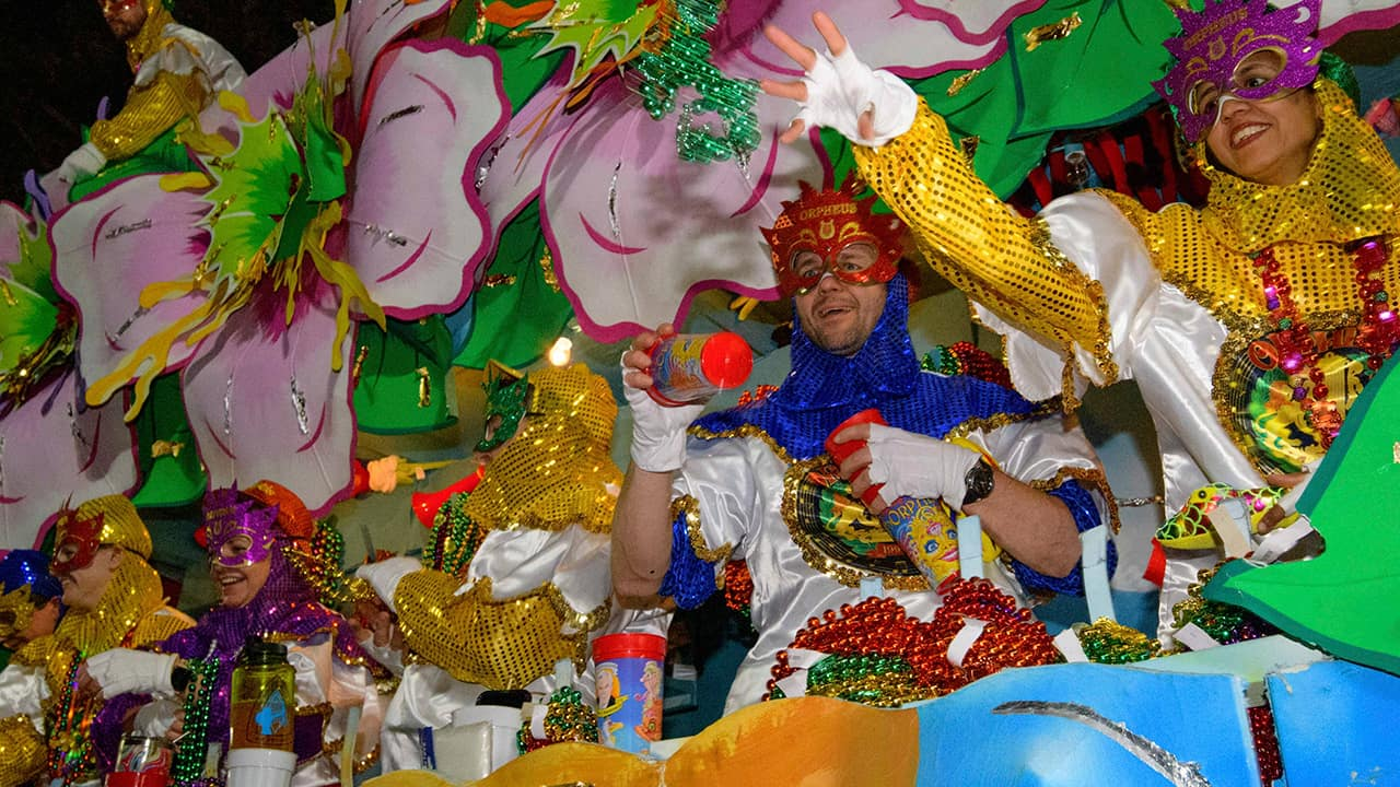 Photo of float riders throwing beads