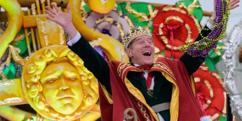 Photo of Actor Bryan Cranston waving beads