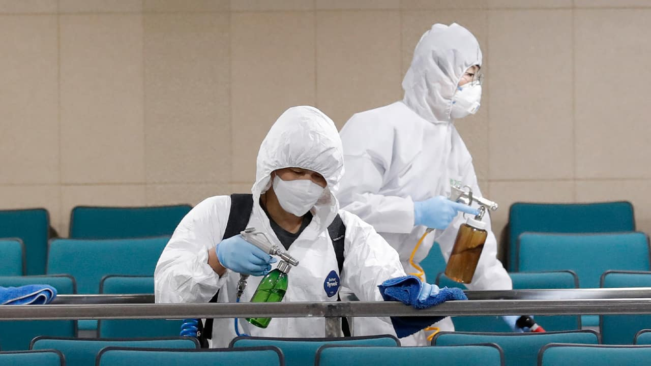 Photo of workers disinfecting a gym in South Korea