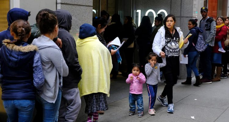 Photo of people outside a U.S. immigration office with numerous courtrooms in San Francisco