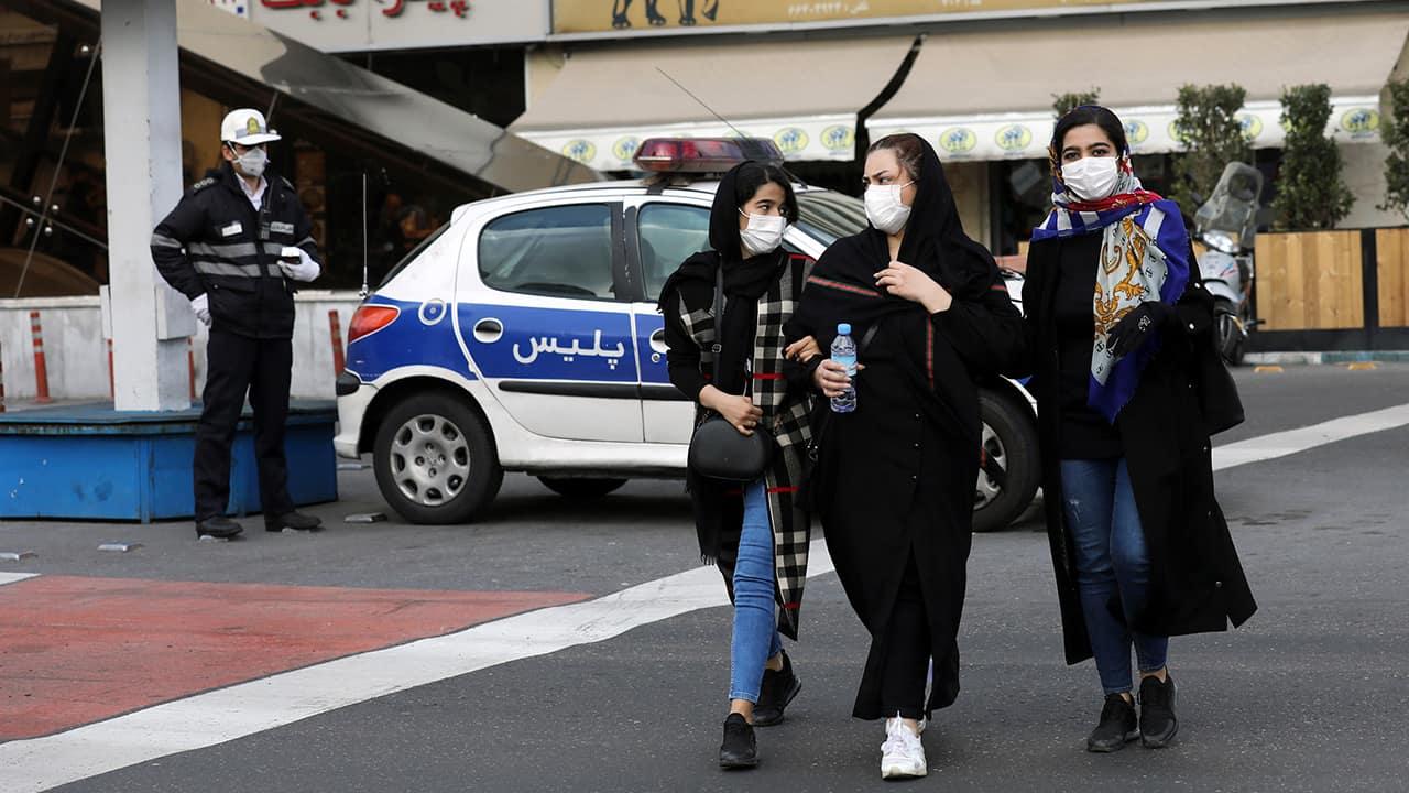 Photo of pedestrians wearing masks in Tehran, Iran