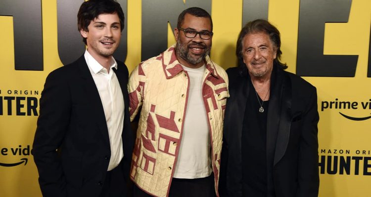 "Photo of Jordan Peele, center, executive producer of the Amazon Prime Video series ""Hunters,"" posing with cast members Logan Lerman, left, and Al Pacino"