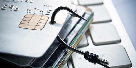 Photo illustration of a fishing hook snagging credit cards symbolizing theft and credit card fraud