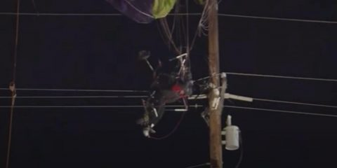 Photo of a paraglider trapped in a power line