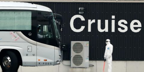 Photo of a bus carrying passengers from the quarantined Diamond Princess
