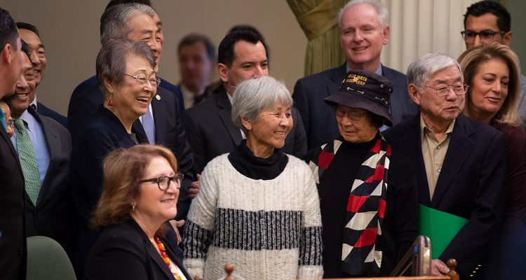 Photo of Japanese Americans who were incarcerated during World War II after the California Assembly passed House Resolution 77