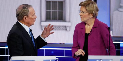 Photo of Democratic presidential candidate, former New York City Mayor Mike Bloomberg talking with Sen. Elizabeth Warren