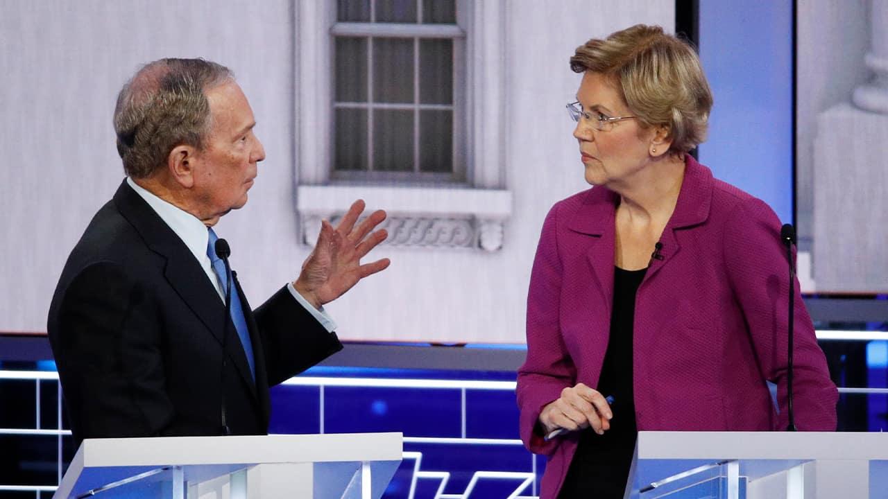 Photo of Democratic presidential candidate, former New York City Mayor Mike Bloomberg talking with Sen. Elizabeth Warren