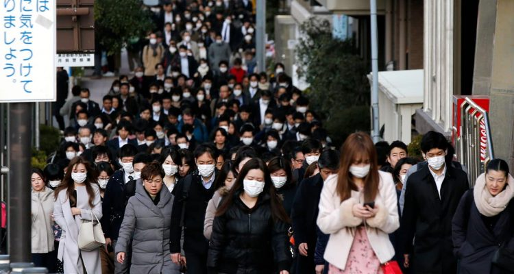 People wearing protective masks in Tokyo, Japan