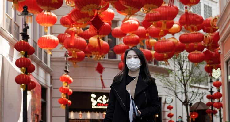 Photo of a woman wearing a mask in Hong Kong
