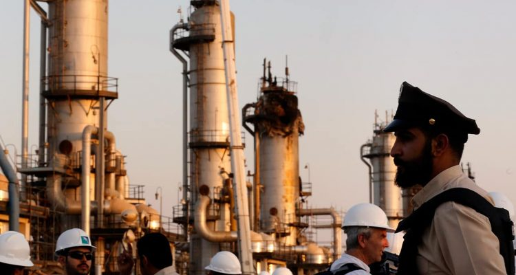 Photo of a guard in front of Aramco's oil facility