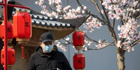 Photo of a man wearing a mask in Beijing, China