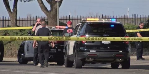 Photo of Fresno police investigating a homicide scene