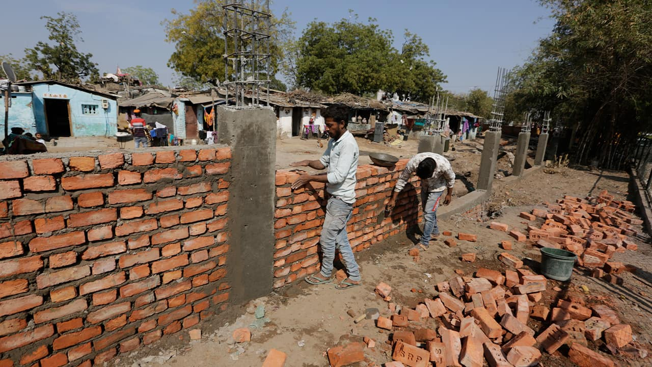 Photo of Indian workers constructing a wall