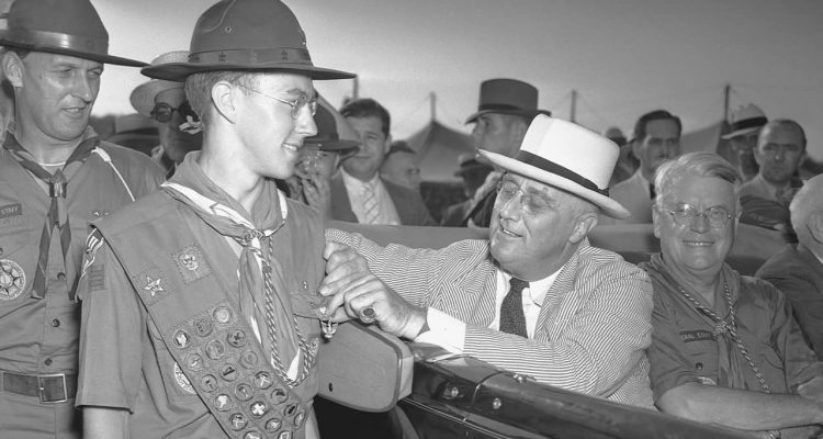 Photo of a boy scout and FDR in 1937