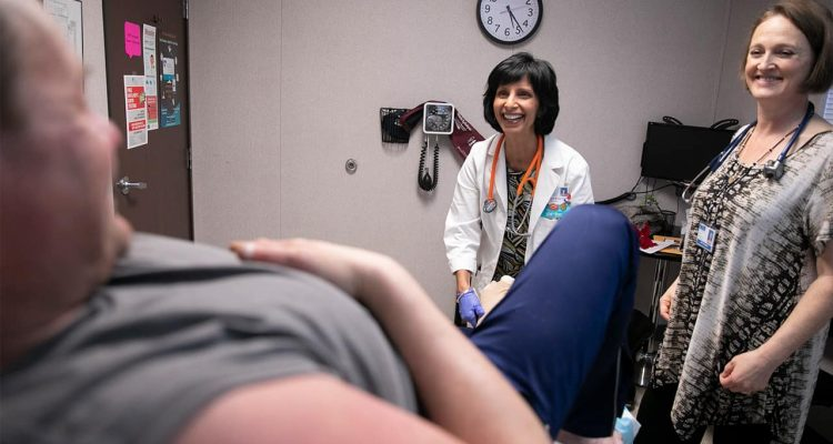 Photo of a nurse practitioner and a nurse practitioner student during an office visit