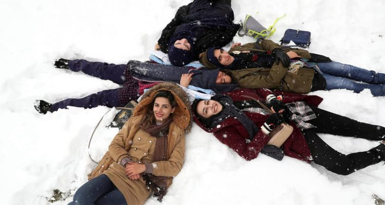 Photo of Iranian women laying in the snow