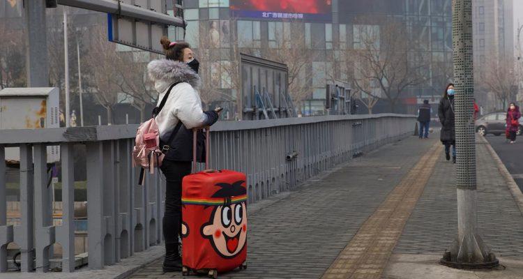 Photo of a traveler standing on a bridge in Beijing