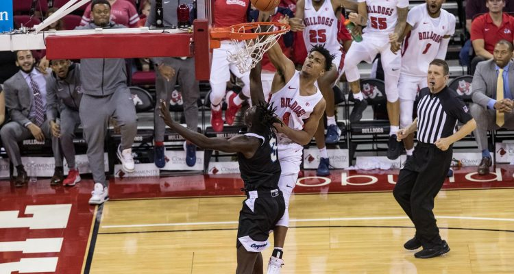 Photo of Fresno State's Niven Hart dunking against San Jose State