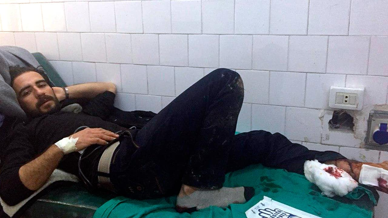 Photo of a Syrian man receiving treatment