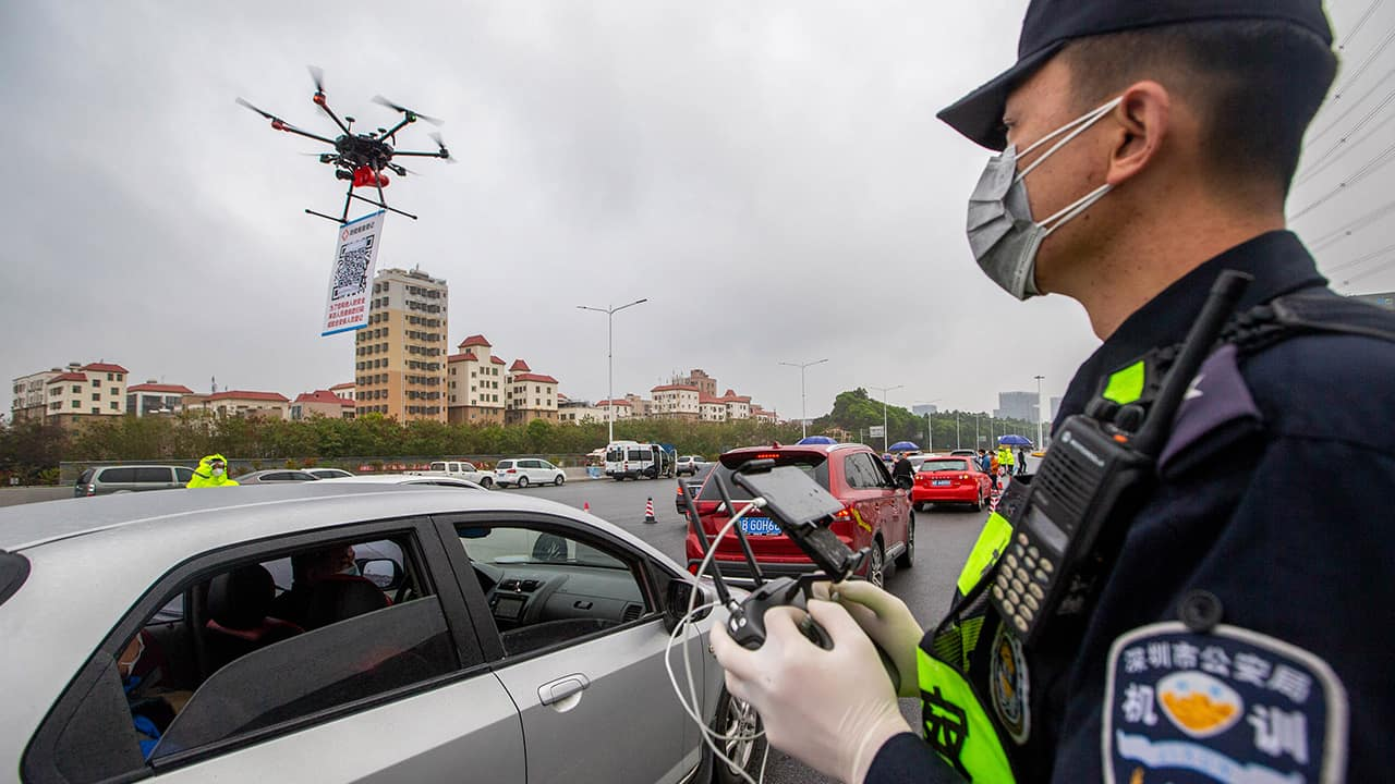 Photo of a police officer operating a drone in China's Guangdong Providence