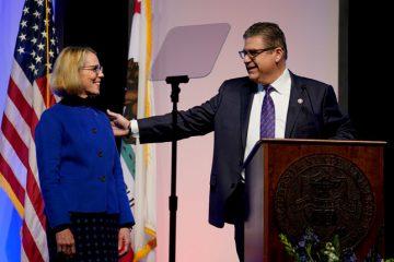 Photo of Joan Eaton with Fresno State President Joseph I. Castro