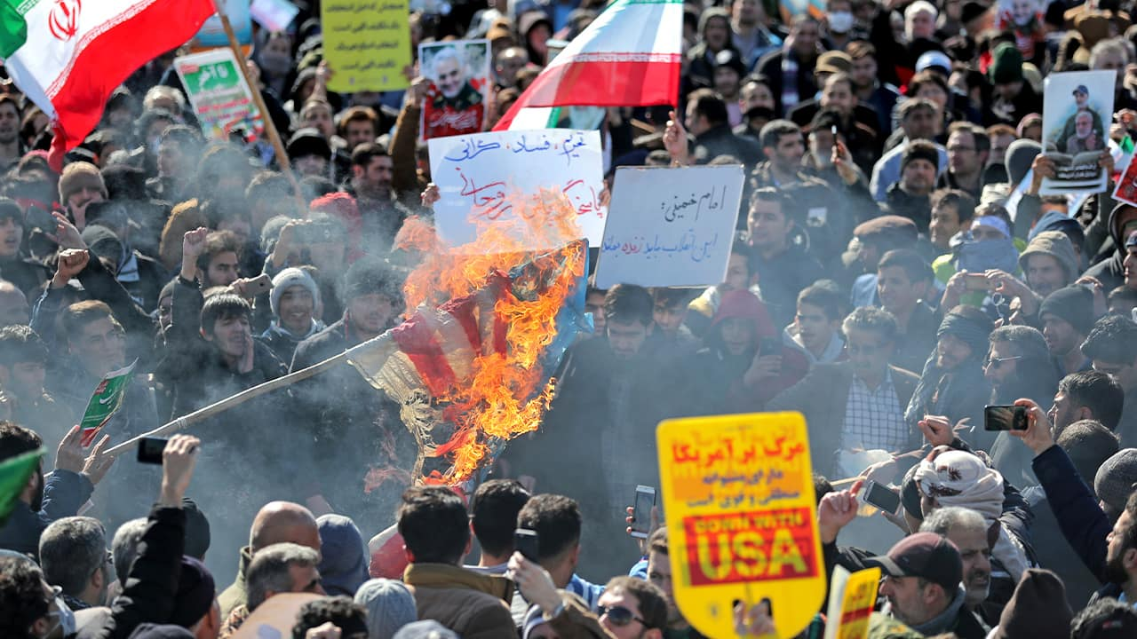 Photo of Iranians burning a U.S. flag during a rally