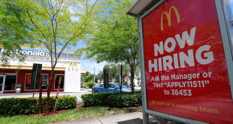 Photo of a Now Hiring sign in front of a McDonald's in Miami