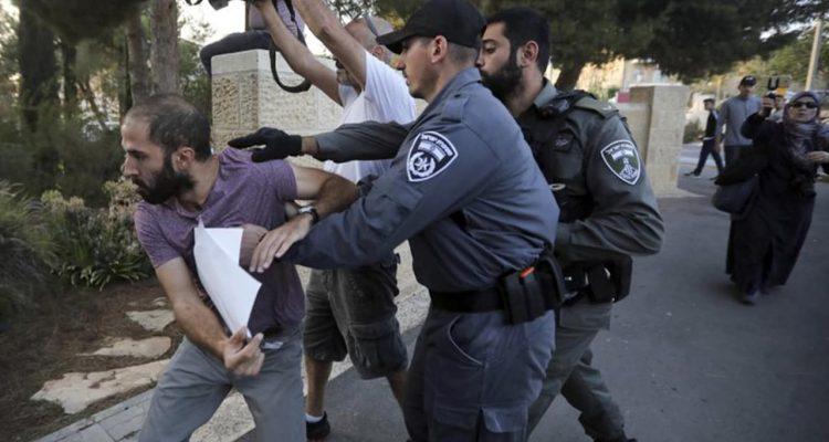 Photo of Israeli police rushing a man
