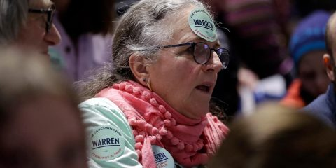 Photo of a woman with a Warren sticker on her forehead
