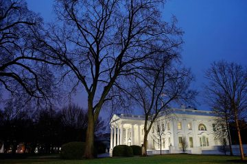 Photo of the White House at night