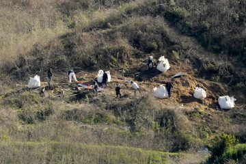 Photo of investigators working at the scene of the helicopter crash that killed Kobe Bryant