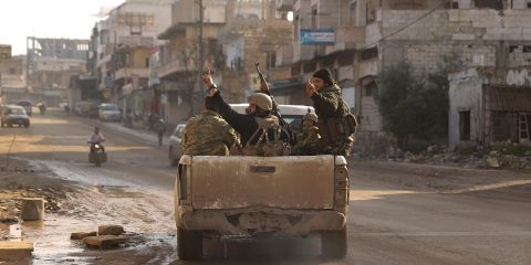 Photo of Syrian rebels driving in Nerab