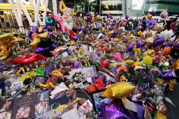 Photo of fans gathering at a memorial for Kobe Bryant