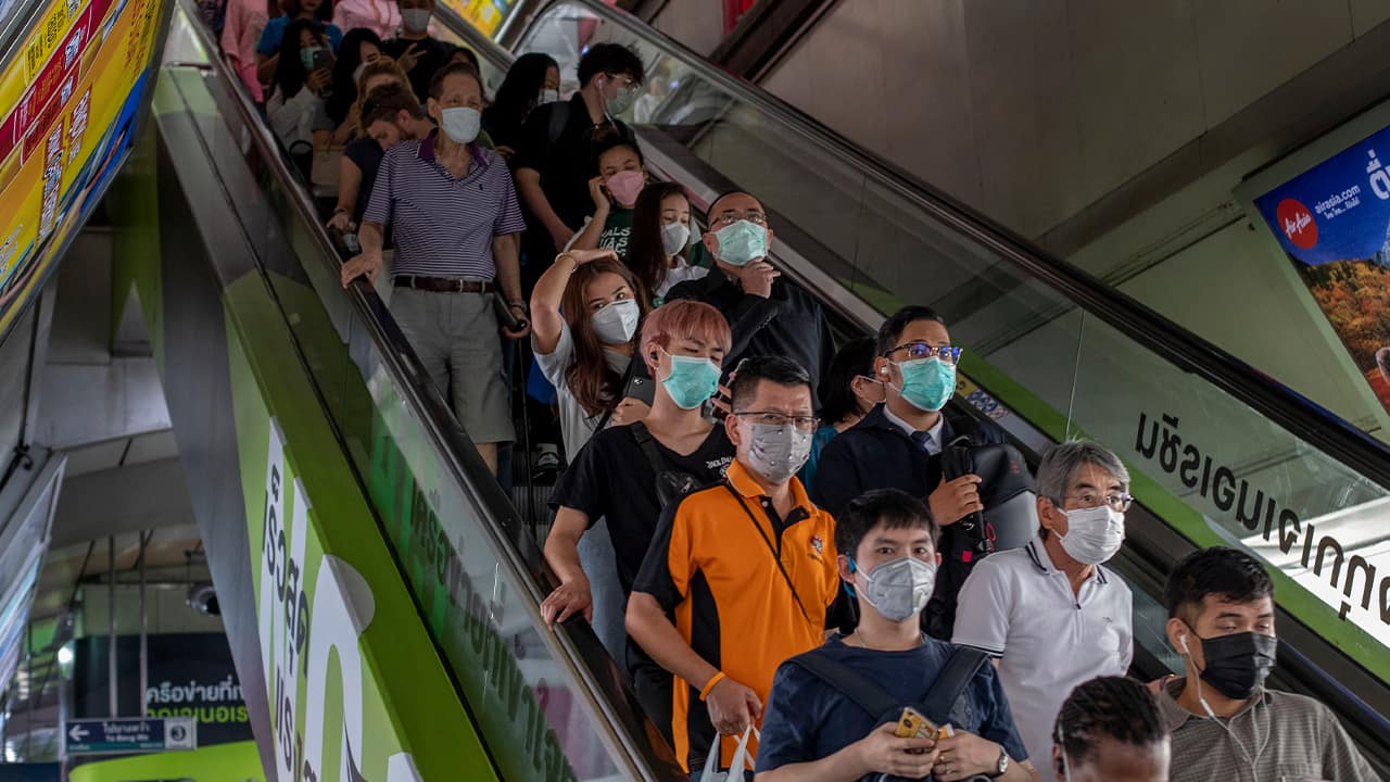 Photo of commuters wearing face masks in Thailand