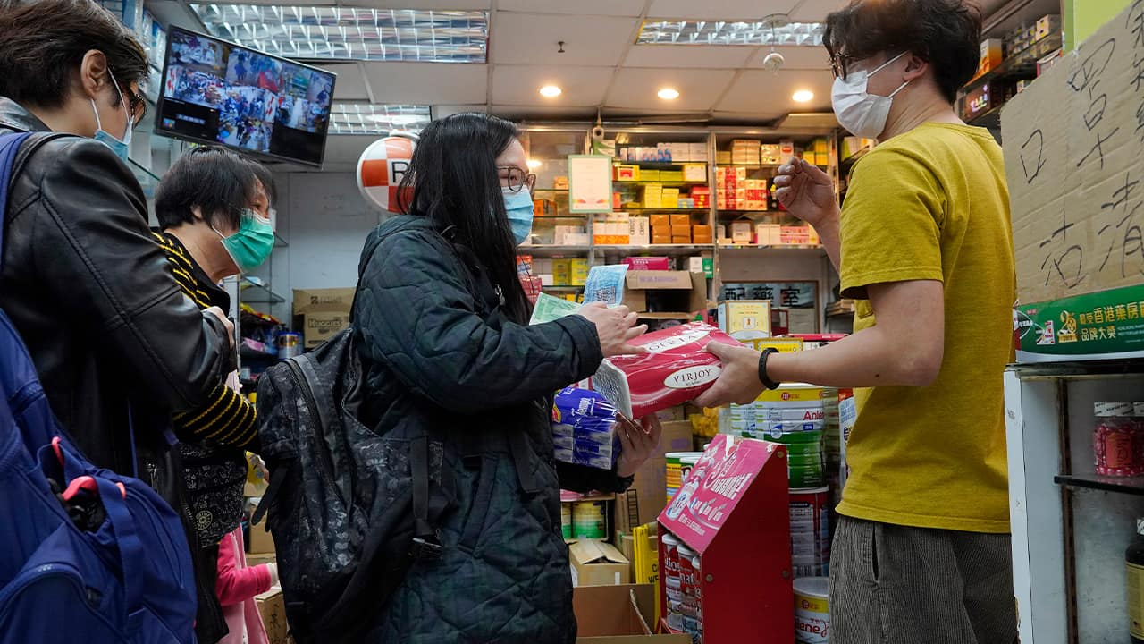 Photo of people wearing face masks at a pharmacy in Hong Kong