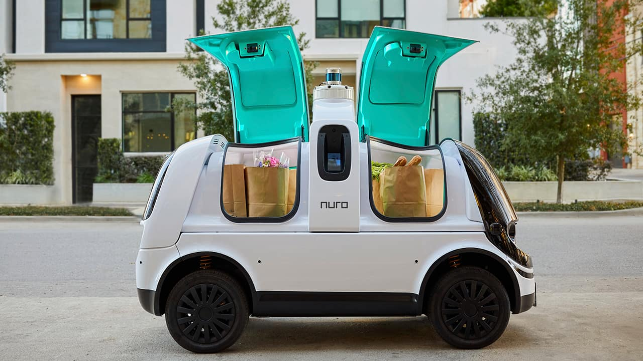 "Photo of Nuro's self-driving vehicle ""R2"" carrying bags of groceries"