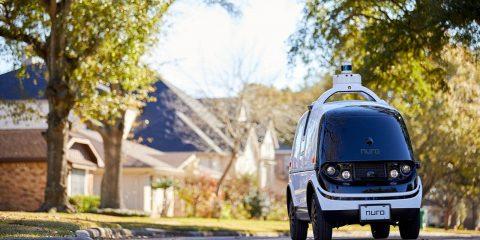 "Photo of Nuro's self-driving vehicle ""R2"" on a neighborhood street"