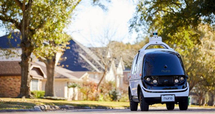 "Photo of Nuro's self-driving vehicle ""R2"" on a neighborhood street"