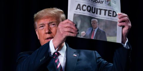 """Photo of President Donald Trump holding up a newspaper that read """"ACQUITTED"""""""