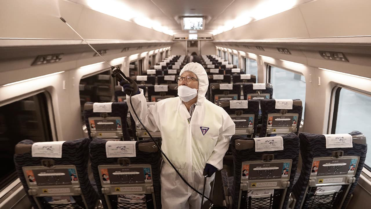 Photo of an employee spraying disinfectant on a train in South Korea