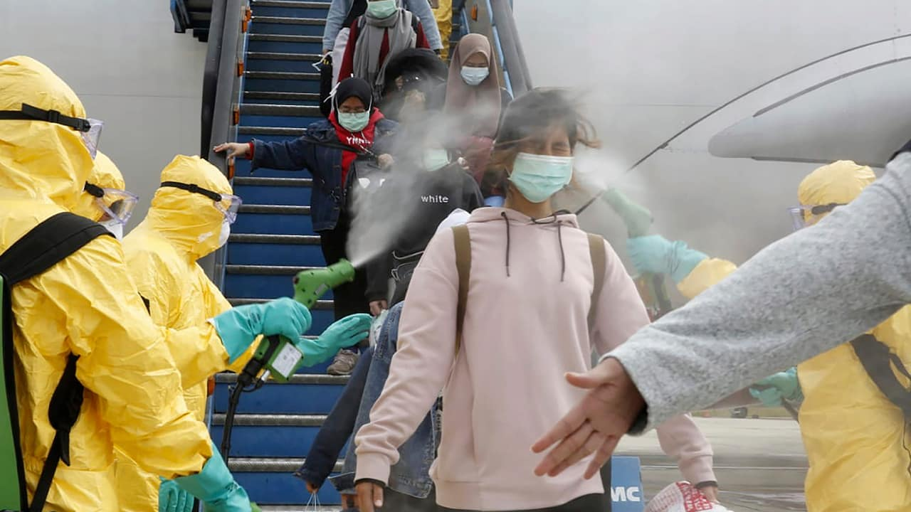 Photo of people being sprayed with antiseptic in Indonesia