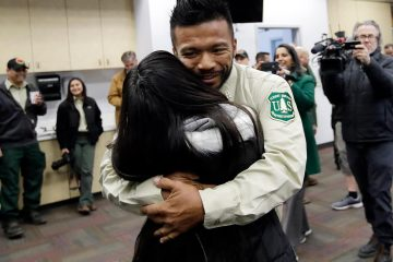 Photo of firefighter Leonard Dimaculangan hugging his daughter
