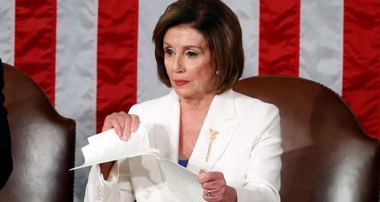 Photo of House Speaker Nancy Pelosi ripping up President Donald Trump's speech