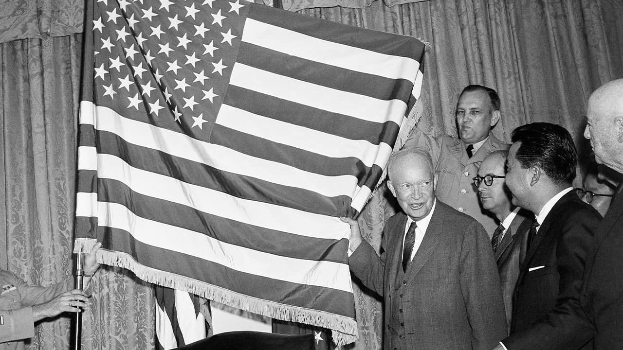 Photo of President Dwight Eisenhower with the new 50-star flag in Washington after signing a proclamation making Hawaii the 50th state of the union in 1959