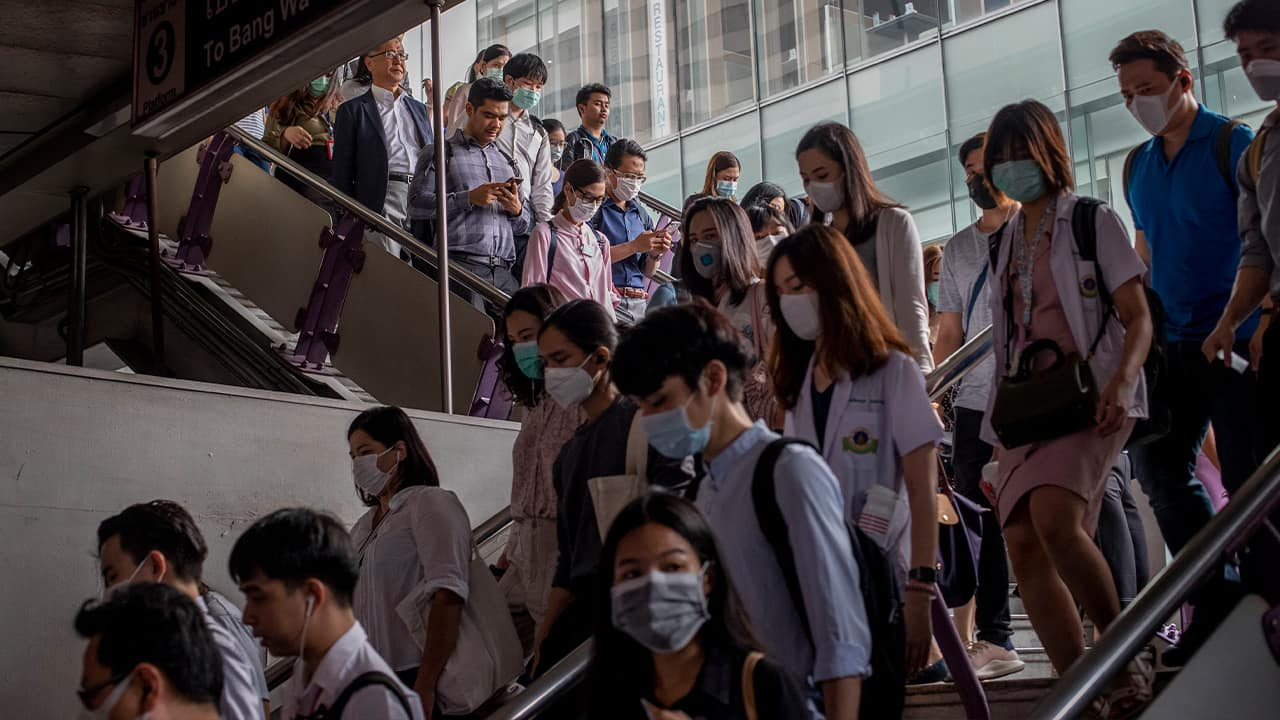 Photo of commuters wearing face masks