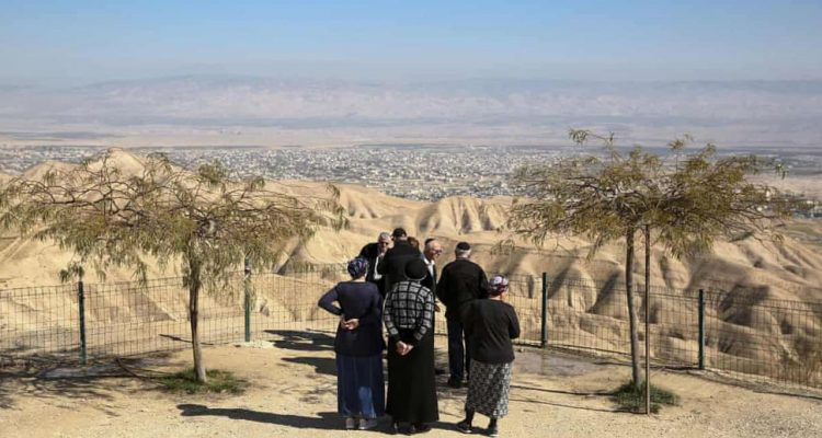 Photo of Jewish settlers overlooking Jericho